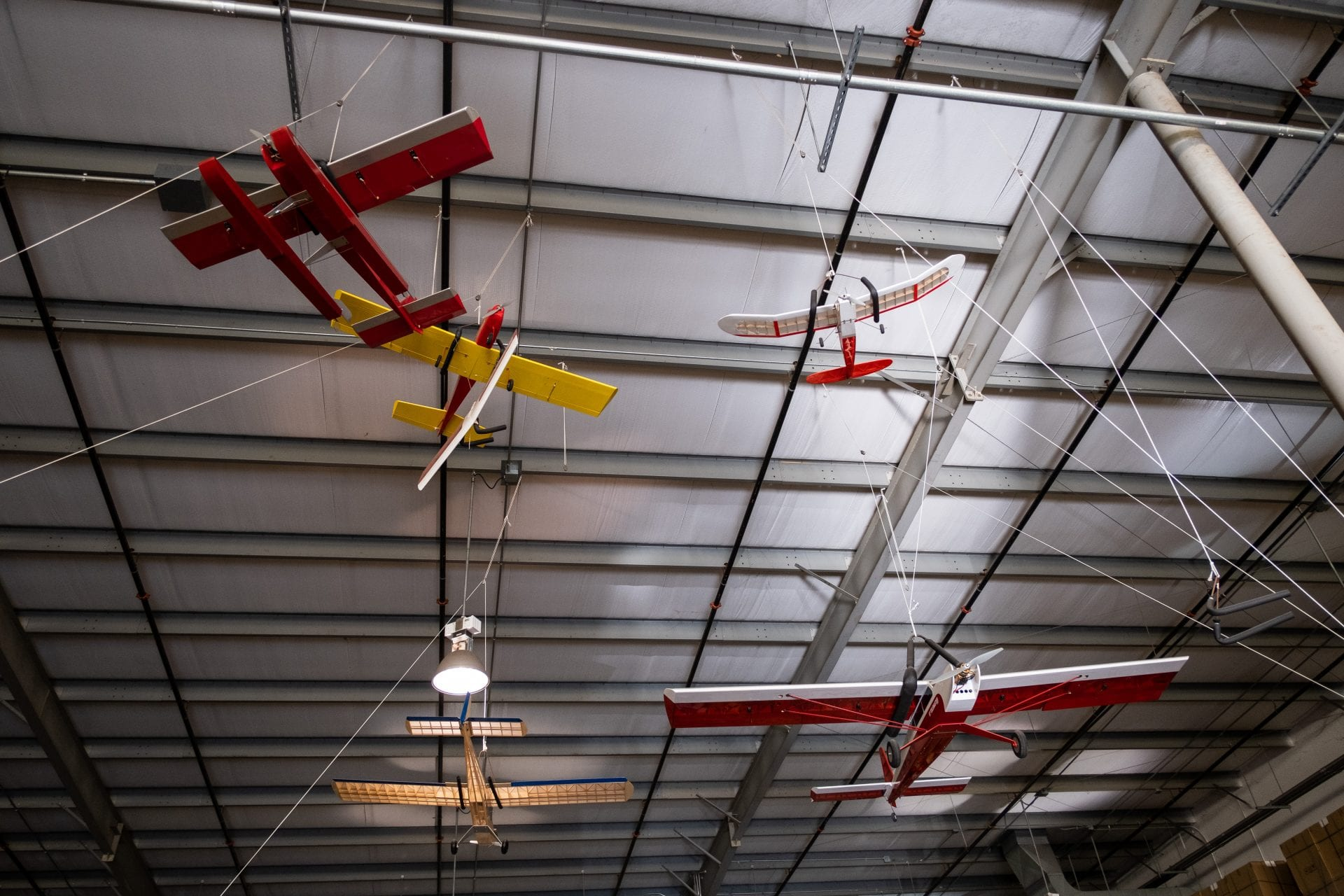 Model Airplanes in the rafters of a Large Warehouse Distribution Center